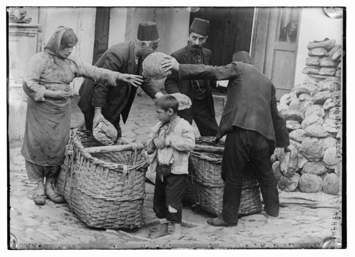 An Armenian family receiving food relief, 1915