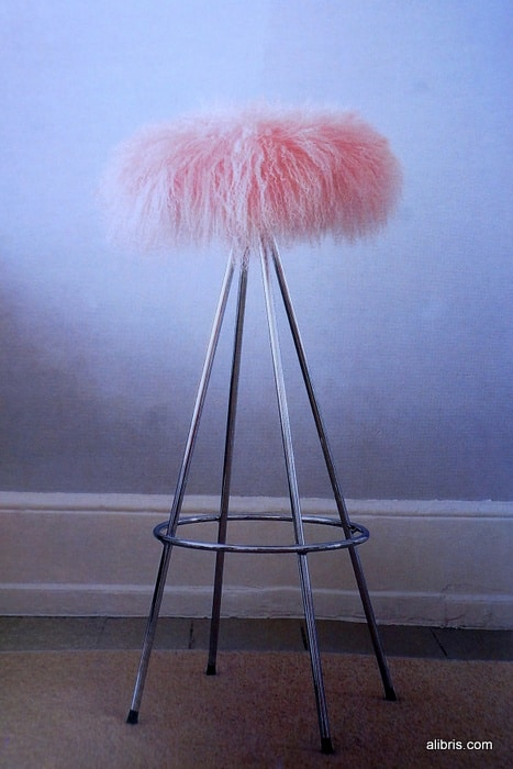 A funky pink furry bar stool cover from the book Shelter Now